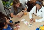 Students sitting playing cards