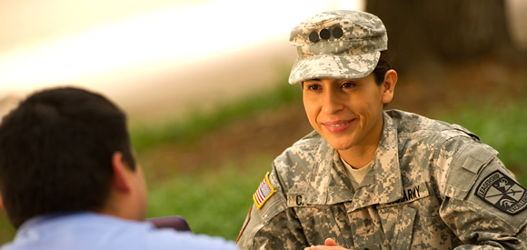 Female military student talking with male