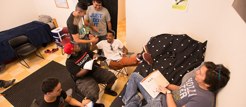 Group of males hanging out in dorm room