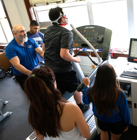Profesor and students conducting testing during kinesiology lab session