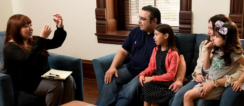 Family sitting on couch during therapy session