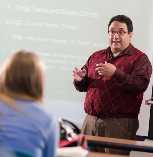 Professor lecturing in the front of the classroom