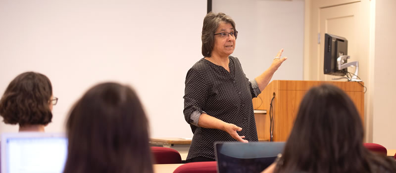 Female professor standing in front of class