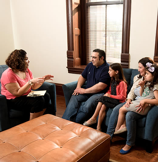 Family in session with social worker